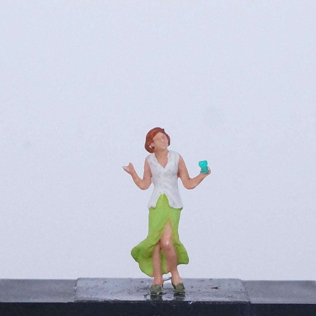 Frau in grünem Rock